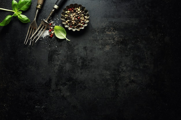 Vintage old rustic cutlery on dark