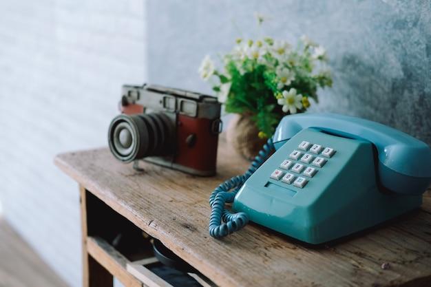 Vintage old telephone camera on wooden desk