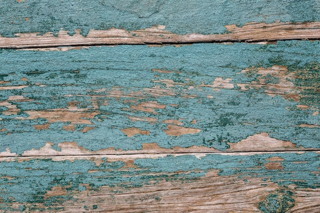 Vintage old wooden texture. green with cracked paint.