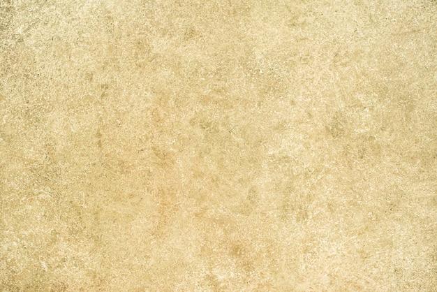 레트로 패턴 벽으로 천연 시멘트 또는 돌 오래 된 텍스처의 빈티지 또는 지저분한 fortuna 골드 배경. 그런지, 재료, 노인, 건설.