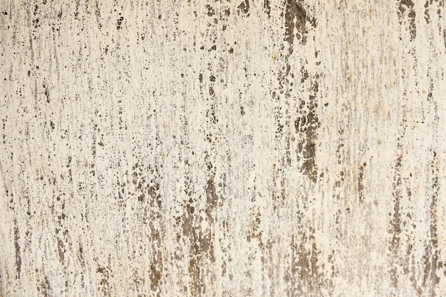 レトロなパターンの壁として自然なセメントや石の古いテクスチャのヴィンテージや汚れた白い背景。
