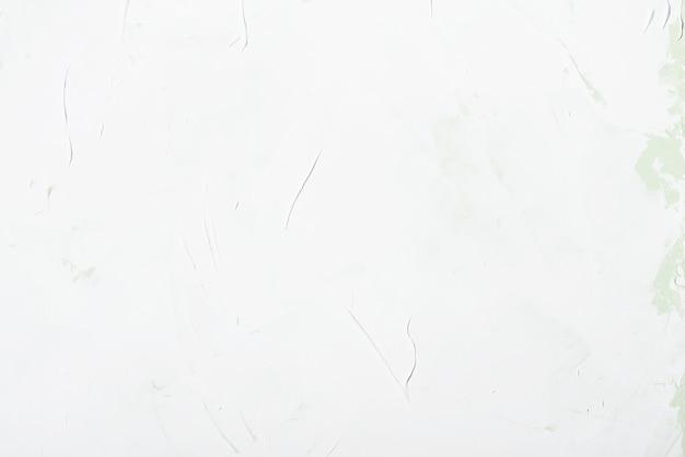 自然なセメントや石の古いテクスチャのヴィンテージや汚れた白い背景