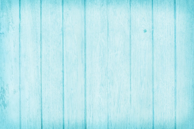 Vintage painted wooden wall background, texture of blue pastel color with natural patterns for art work.