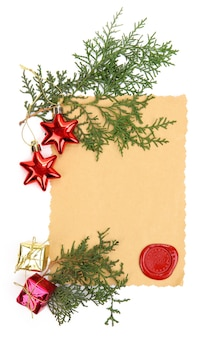 Vintage paper and christmas decorations isolated on white