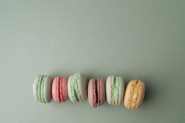 Vintage pastel colored french macarons on green