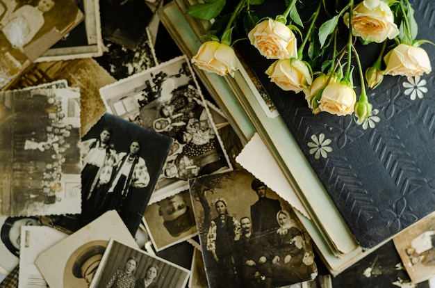 Vintage photo album with family photos. life values and generations concept.