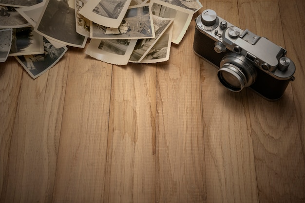 Vintage photo camera with old photos