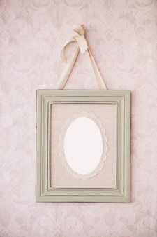 Vintage photo frame hanging on the wall