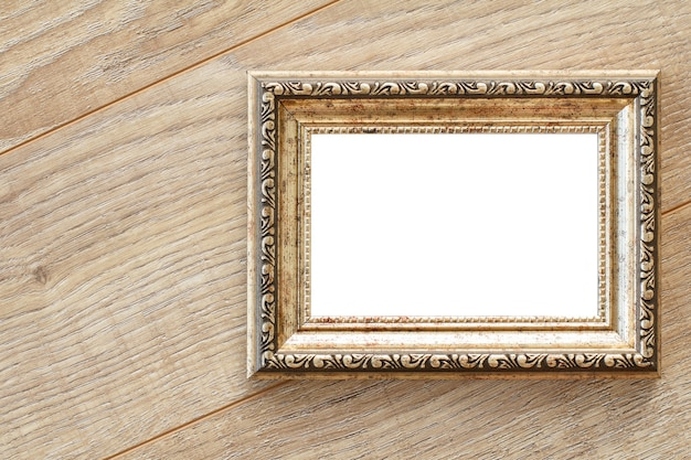 Vintage photo frame with copy space on wooden boards.