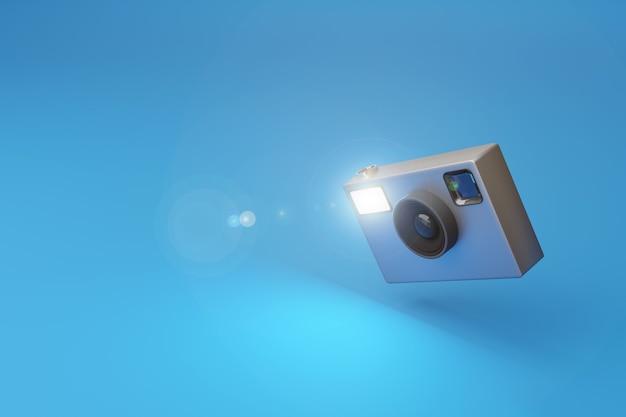 파란색 배경에 플래시를 발사하는 빈티지 사진 카메라.