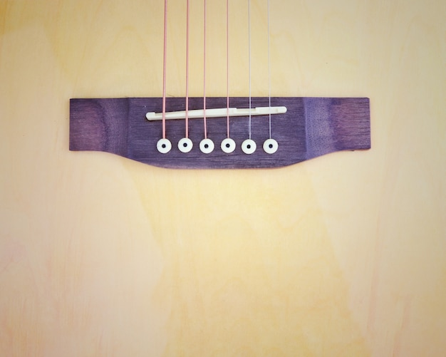 Vintage phto of acoustic guitar strings close up top view abstract background