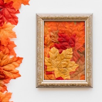 Vintage picture frame with autumn leaves