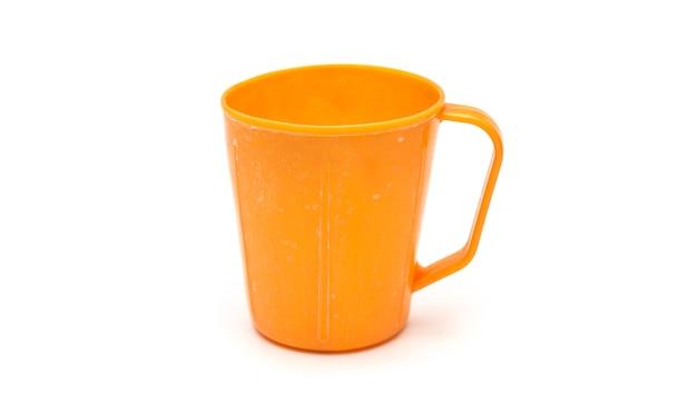 Vintage plastic mug isolated on white background