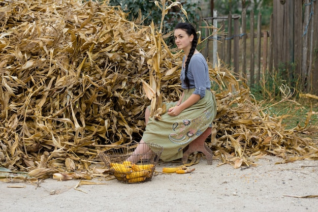 Vintage portrait of a sexy girl with corn, concept of rural harvesting