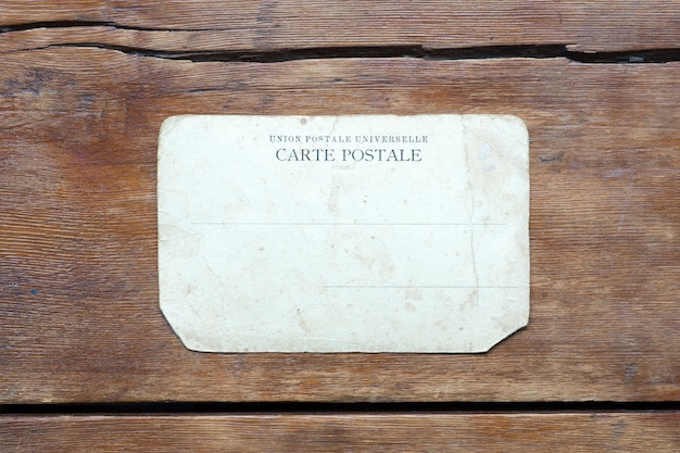 Vintage post card on the weathered wooden table