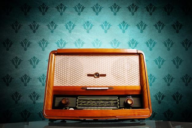 Vintage radio on blue background