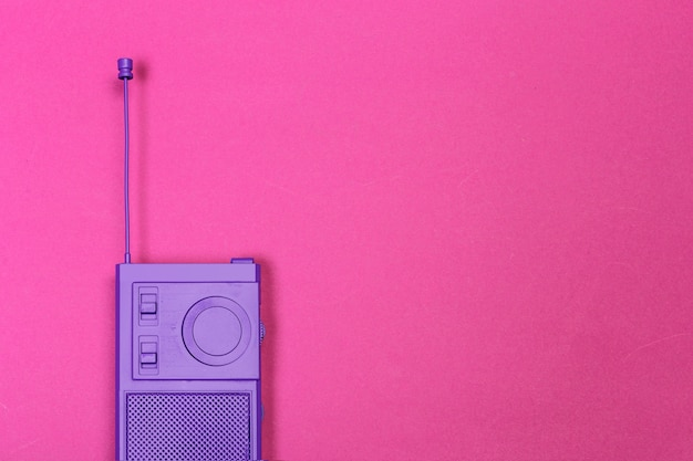 Vintage radio on color background.