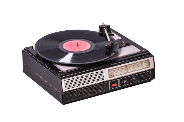 白で隔離のラジオチューナーとビンテージレコードプレーヤー