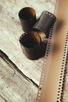 Vintage reel camera tape on wood