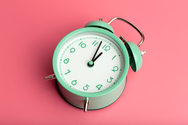 Vintage retro alarm clock on a blank colored minimal background time clock timing concept high quali...