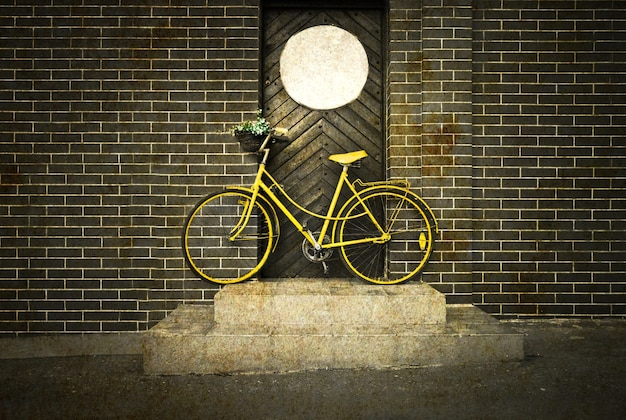Vintage retro old yellow bike on the street.