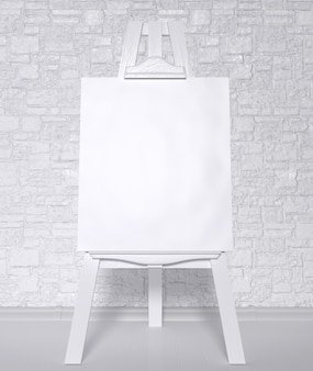 Vintage retro wooden easel artist's with blank canvas on a brick wall background.