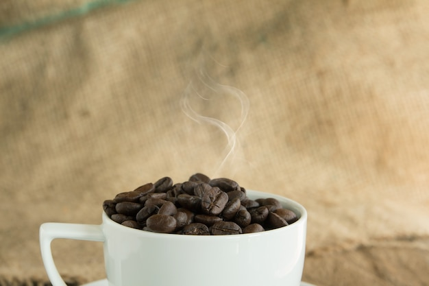 Vintage roasted coffee beans on wooden background