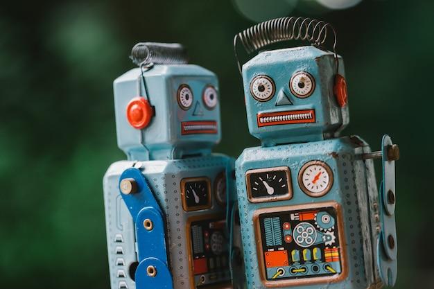 Vintage robot tin toy on yello background
