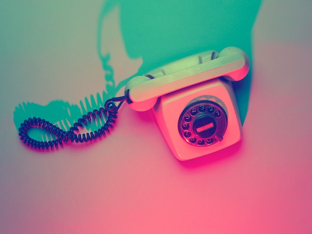 Vintage rotary retro phone in ultraviolet light