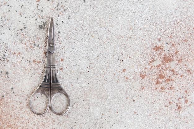 Vintage scissors on a concrete background