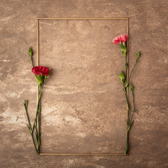 Vintage sepia frame with small carnation flowers