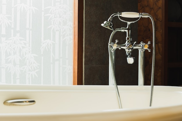 Vintage silver hot and cold faucet at bath basin in luxury hotel.