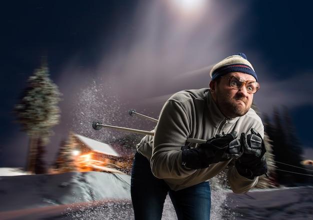 夜に速くスキーをするメガネのヴィンテージスキーヤー