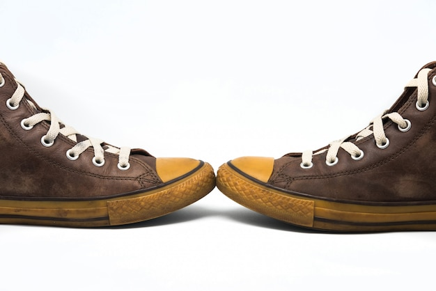 Vintage sneakers on white background