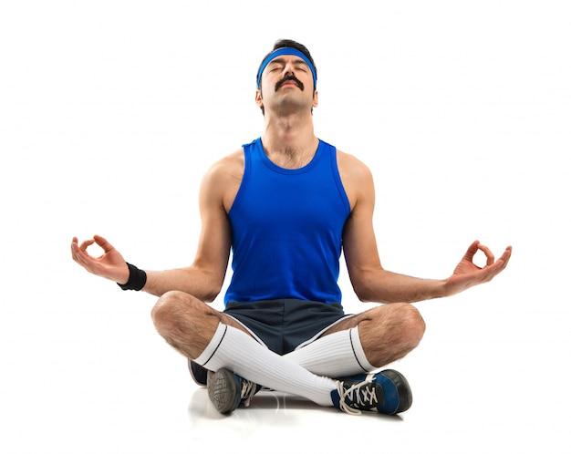 Vintage sportman in zen position