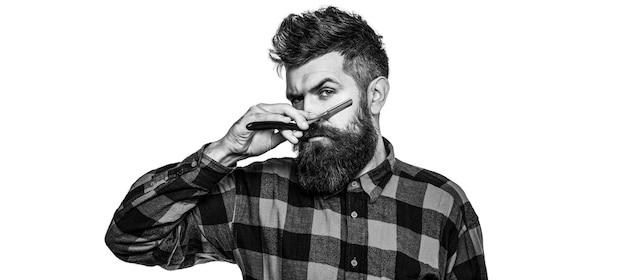 Винтажная опасная бритва. мужская стрижка в парикмахерской. парикмахерская опасная бритва, парикмахерская. черное и белое.