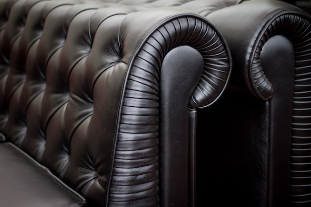 Vintage style of interior decoration the black leather sofa.
