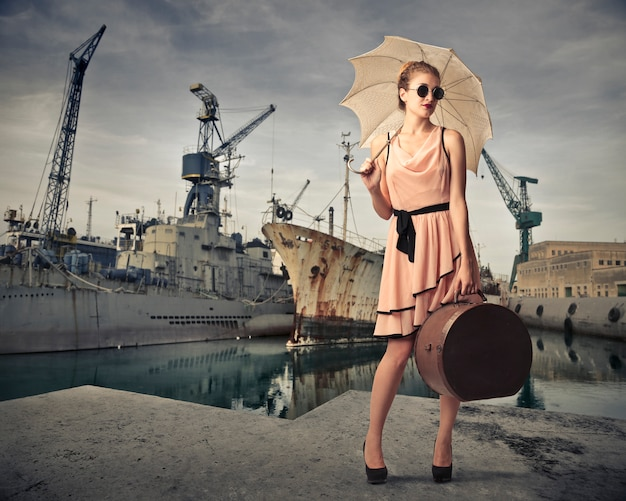 Vintage style woman at a port
