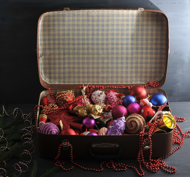 Vintage suitcase with festive christmas decorations for the christmas tree