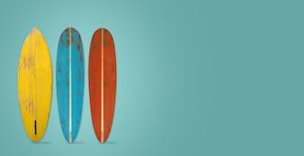 Vintage surfboard on color background