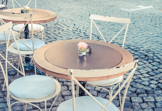 Vintage table and chairs in street cafe terrace, alacati, turkey