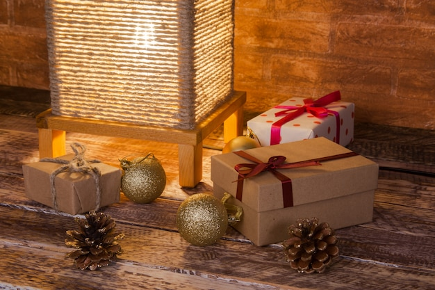 Vintage table lamp, gift boxes and colored christmas balls