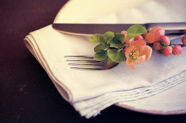 Vintage table setting with delicate flowers