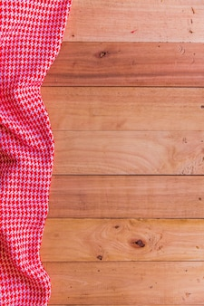 Vintage tablecloth on old wooden table, holiday concept