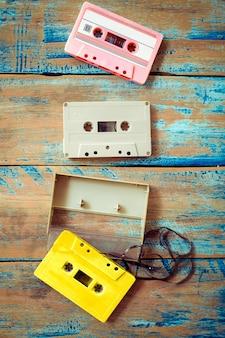 Vintage tape cassette recorder on wood background