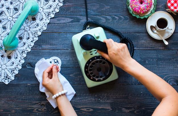 Vintage telephone coffe biscotti phone call sad woman