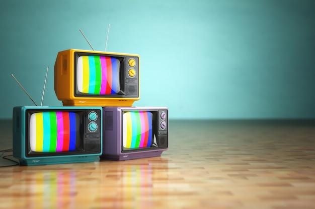 ヴィンテージテレビのコンセプト。緑の背景にレトロなテレビセットのスタック。 3d