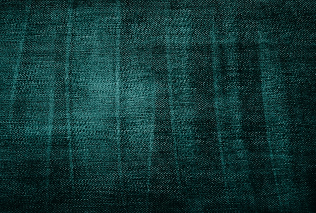 Vintage threadbare green fabric texture