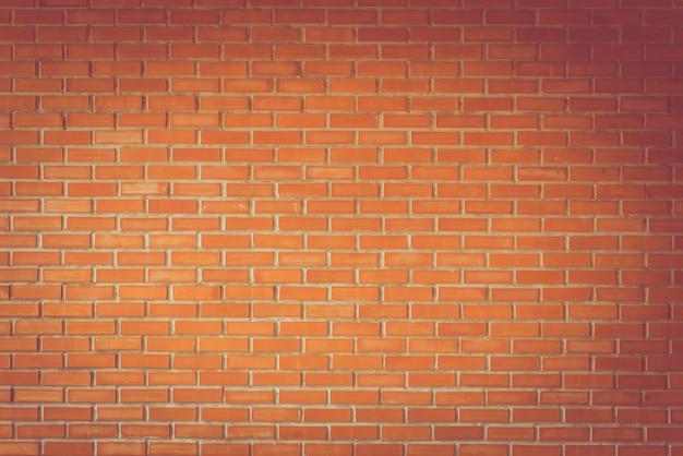 オレンジ色の粘土レンガの壁のテクスチャのバックグラウンドのヴィンテージ調、建築の壁の詳細