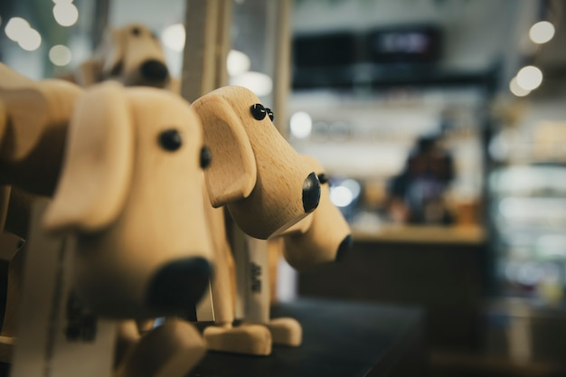 Vintage tone wooden dog toy with blur bokeh background